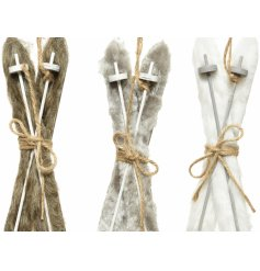 A fuzzy assortment of hanging ski decorations, each complete with its own colouring and added jute string touch