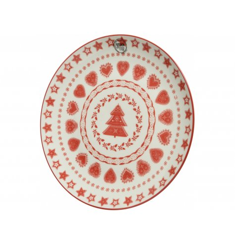 A red and white patterned plate with a Christmas charm