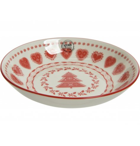 A red and white patterned bowl with a Christmas charm