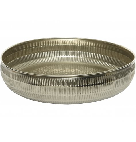A tarnished silver toned metal bowl featuring a hammered edging, perfect for decorative use on table centres
