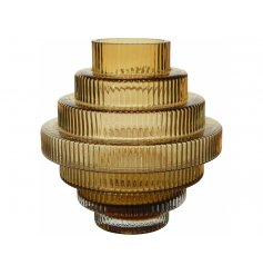 A stunning stacked inspired glass vase featuring a surrounding ridged look and soft flaxen yellow tone