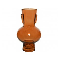 A gorgeously designed glass vase featuring a structured look and sleek soft orange hue to complete its look