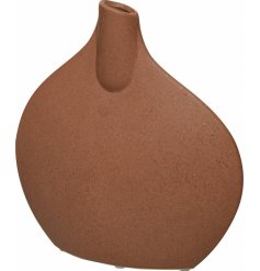 A stunningly simple designed flat shaped vase with a terracotta tone and trendy look