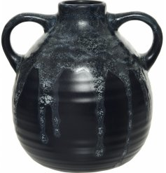 A stunningly simple smooth to the touch decorative Jug featuring a bold black tone and reactive glaze drip finish