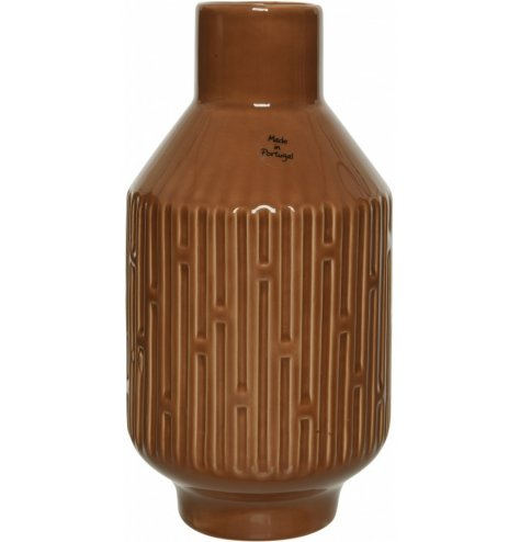A Moroccan inspired shaped vase with added embossed textures and a terracotta tone