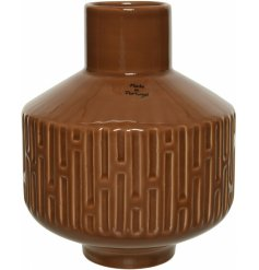 An Earthen inspired decorative vase, set with an embossed decal and terracotta colouring