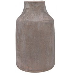 A stunningly simple terracotta based ornamental vase with a sandy texture finish