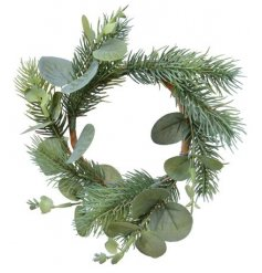 A chic and simple small round wreath covered with artificial foliage and eucalyptus