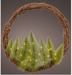 a large willow wrapped wreath combined with frosted trees and LED lights