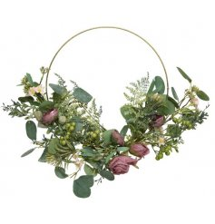 Add a hint of romance to your festive displays with this stunningly presented artificial rose wreath
