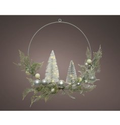 Add a hint of winter to your festive displays with this stunningly presented artificial foliage wreath