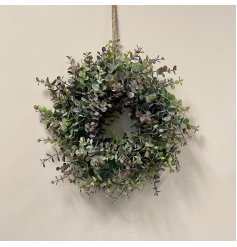 A large wreath full of artificial eucalyptus foliage and added purple tints for an authentic look