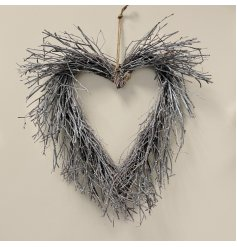 A charming rustic living heart wreath with a subtle white washed finish.