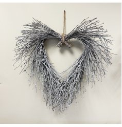 A charmingly rustic inspired twig heart wreath with a subtle white washed finish.