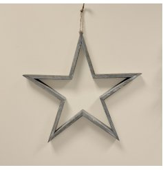 A rustic living grey wooden star with a washed finish and jute hanger.