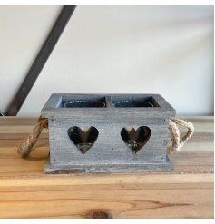 A grey wash painted wooden candle holder tray set with a 2 space inner for candles