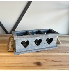 A grey wash painted wooden candle holder tray set with a 3 space inner for candles