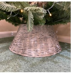 Perfect for hiding light wires and ugly metal bases, a woven willow tree skirt with a rustic charm and simple setting
