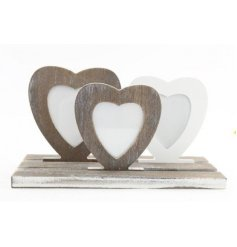 A charming set of small shaped wooden picture frames set on a wooden base
