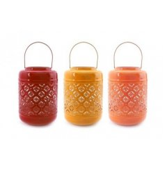 An assortment of tall iron lanterns decorated with autumnal themed tones and geometric cut patterns