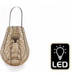 A wood framed lantern with a fitted Solar LED Bulb, with its added handle for hanging use also this lantern is a must