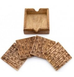 A set of Mango Wood coasters with a stylish bamboo print on each