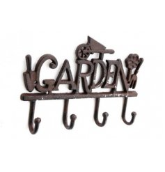 An overly distressed iron based wall hook featuring a Garden Text and added decals