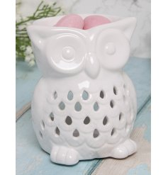 an owl shaped wax/oil burner in a simple white hue