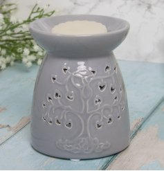 A grey toned ceramic tlight holder, beautifully decorated with a Tree of Life decal and dipped dish for wax melting