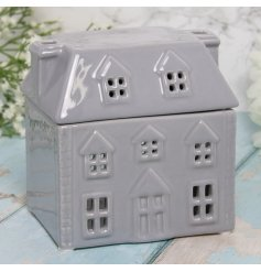 A sweet little ceramic house shaped oil burner complete with a removable lid for added charm
