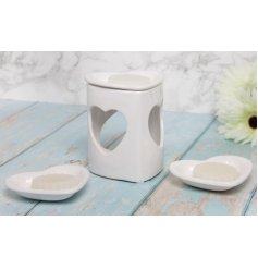 A white toned heart cut wax burners with removable heart shaped dishes