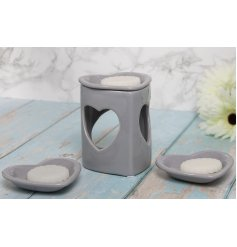 A grey toned heart cut wax burners with removable heart shaped dishes
