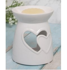 A sleek and simple white ceramic wax/oil burner, beautifully decorated with a double heart cut window