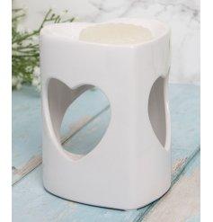 A sweetheart inspired ceramic wax warmer with added heart cut windows and a sleek white finishing tone