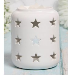 A charming little ceramic tlight holder with an added dipped top and pretty star cut decal surrounding it