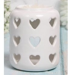A tall standing ceramic based tlight holder featuring a dipped top and heart cut