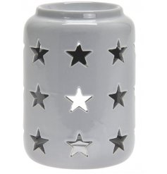A tall standing ceramic based tlight holder featuring a dipped top and star cut