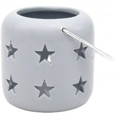 A sweet and simple little grey T-light holder set with cut star decals