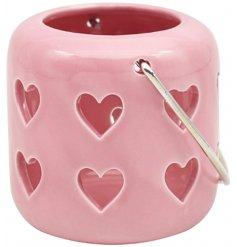 A sweet and simple little pink T-light holder set with cut heart decals