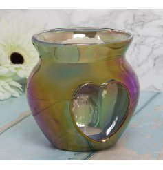 A small glass wax warmer set with a stunning Iridescent tone and heart cut window decal