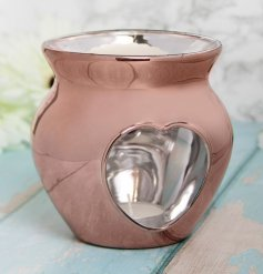 A small glass wax warmer set with a trending Rose Gold tone and heart cut window decal