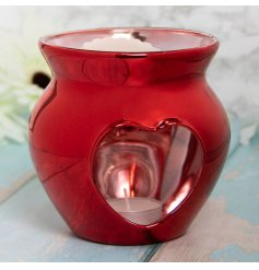 A small glass wax warmer set with a stunning deep red tone and heart cut window decal