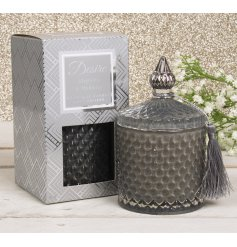 A Soy Candle set within a diamond ridge decorated pot with added tassel feature