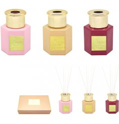 An assorted set of scented diffusers, each in their own boldly coloured bottles