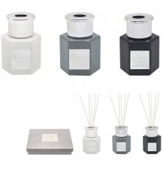 An assorted set of scented diffusers, each in their own soft coloured bottles