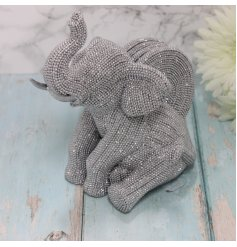 An elephant shaped Stand and 4 matching coasters that fit together, perfectly covered with glittery bling accents