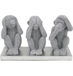 Sure to bring a bold statement look to any space of the home, a trio of sitting monkeys covered with a glitzy bling deca