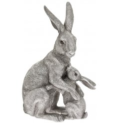 A sleek and beautifully detailed posed Hare & Baby Ornament in a silver art tone