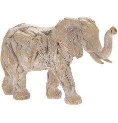 A standing Driftwood inspired Elephant Figure, complete with a Rustic Feel and Look.