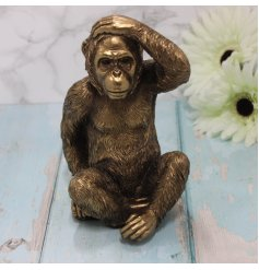 Sure to bring a delightful feel to any home space, a posed Gorilla ornament in a bronzed tone